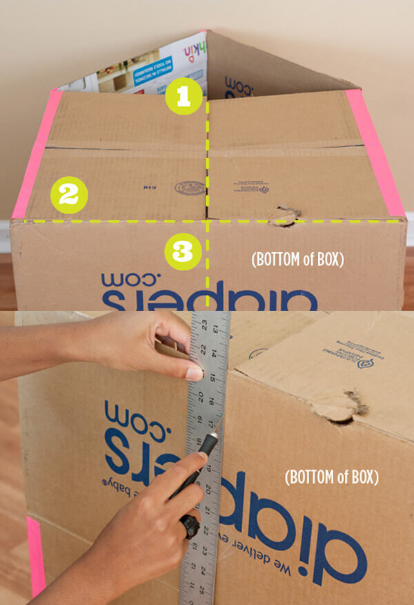 Bước 8 cách làm nhà bằng bìa cứng cho bé - Lật úp ngôi nhà xuống sàn. Dùng kéo cắt một đường ở chính giữa phần lưng và phần dưới của ngôi nhà để làm cửa